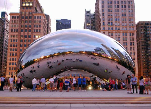 поехать в Чикаго