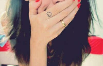 Tattoo heart on finger