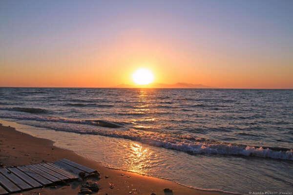 Встретить рассвет на берегу моря