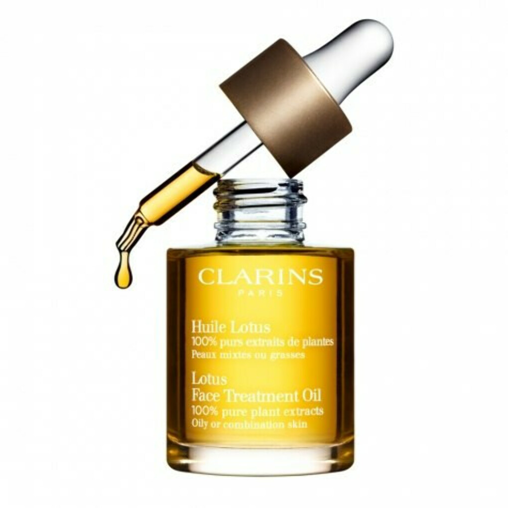 масло clarins lotus face treatment oil
