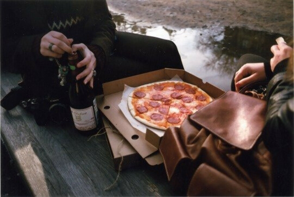 Enjoy the pizza in the company of friends