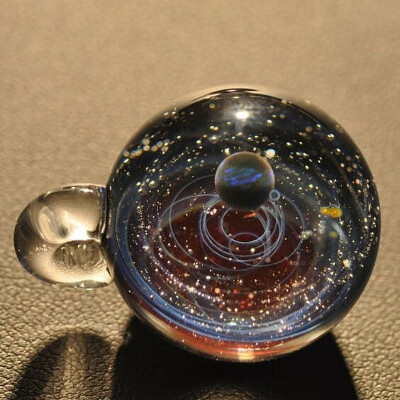 Glass ball with the Universe