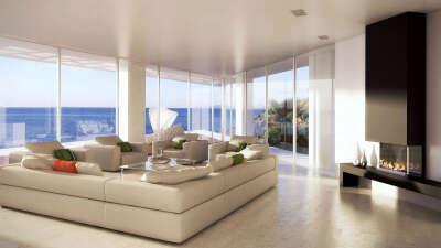 Дом на берегу моря с большими окнами