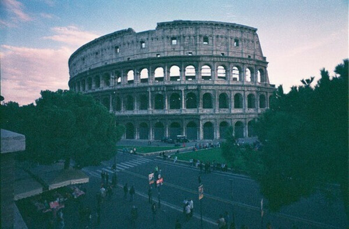 поехать в Рим