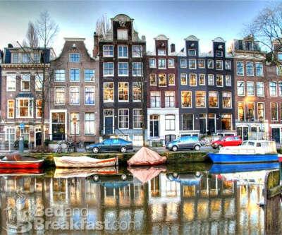 в Амстердам#