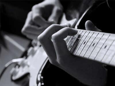 Обучиться игре на гитаре