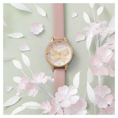 Armbanduhr in hellbraun und Gold