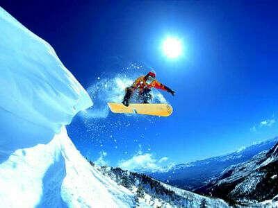 Кататься на сноуборде
