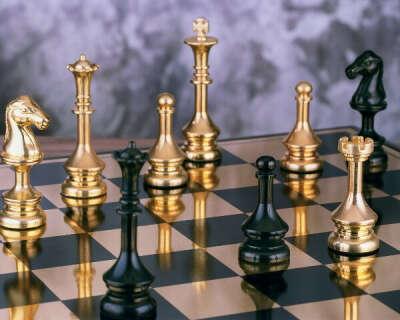 научиться играть в шахматы