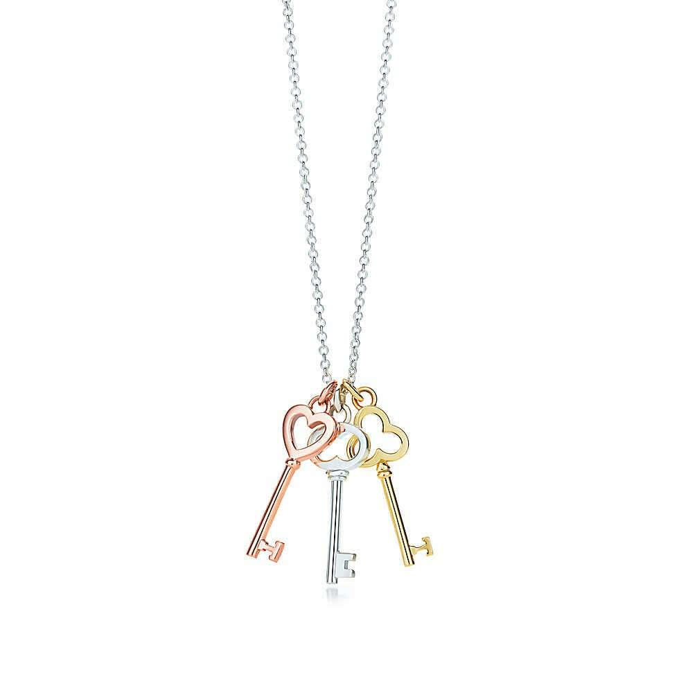 Tiffany & Co. -  Tiffany Keys mini three-key pendant in silver and 18k rose and yellow gold.